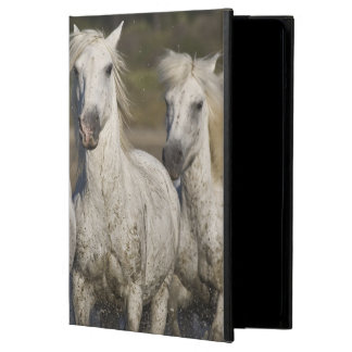 France, Camargue. Horses run through the 2 iPad Air Covers