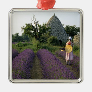 France, PACA, Vaucluse, Woman in a lavender Silver-Colored Square Decoration