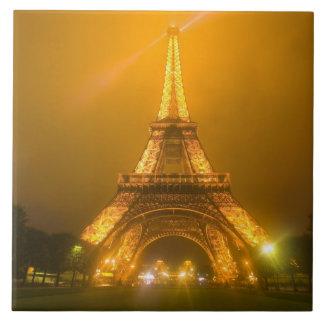 France, Paris. Eiffel Tower illuminated at 3 Tiles