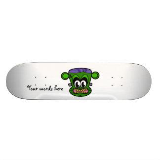 Frankenstein monkey in green skateboard decks