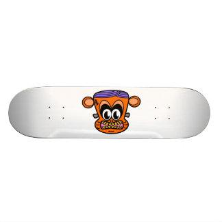 Frankenstein monkey in orange skateboard decks