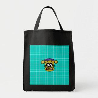 Frankenstein monkey on blue tile background bag