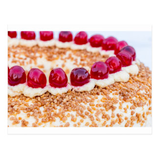 Frankfurt crown cake with cherries on rustic wood postcard