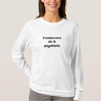 Freelancers do it anywhere. T-Shirt