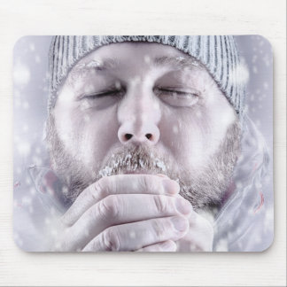 Freezing cold man in snow storm artwork mousepad