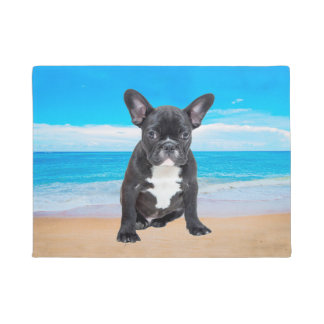 French Bulldog Sitting On Beach Doormat
