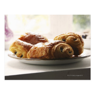 french croissants on a plate postcard