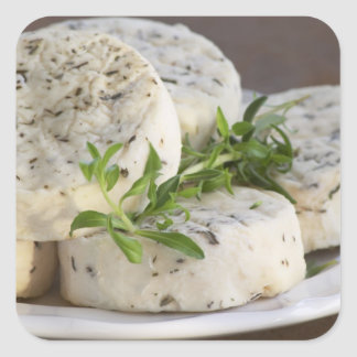 French goat cheese - chevre - with herbs on a square sticker