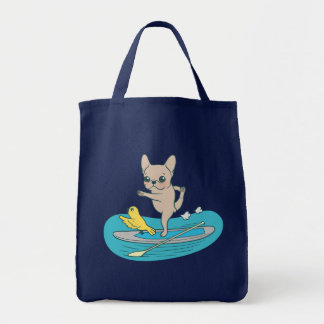 Frenchie doing yoga on stand-up paddle board tote bag