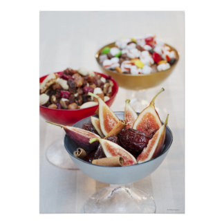 Fresh and dried fruits in bowls poster