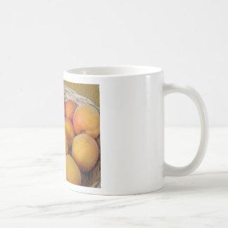 Fresh apricots in a wicker basket coffee mug