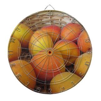 Fresh apricots in a wicker basket dartboard