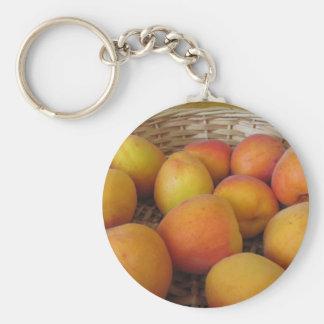 Fresh apricots in a wicker basket key ring