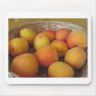 Fresh apricots in a wicker basket mouse pad