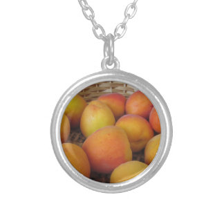 Fresh apricots in a wicker basket silver plated necklace