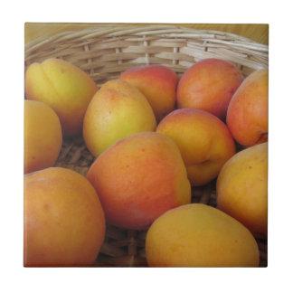 Fresh apricots in a wicker basket tile