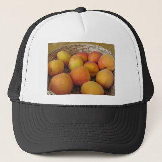 Fresh apricots in a wicker basket trucker hat