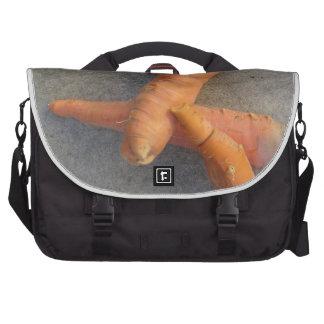 Fresh carrots on the floor commuter bag