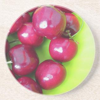 Fresh cherries on green background sandstone coaster