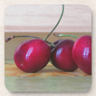 Fresh cherries on the table drink coaster