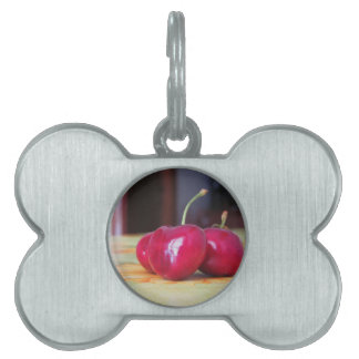 Fresh cherries on the table pet name tags