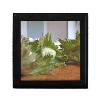Fresh green hazelnuts on a wooden table gift box
