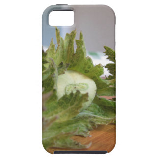 Fresh green hazelnuts on a wooden table iPhone 5 cases