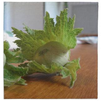 Fresh green hazelnuts on a wooden table napkin