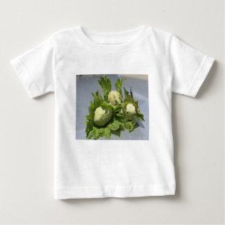 Fresh green hazelnuts on glittering background baby T-Shirt
