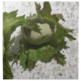 Fresh green hazelnuts on the floor napkin