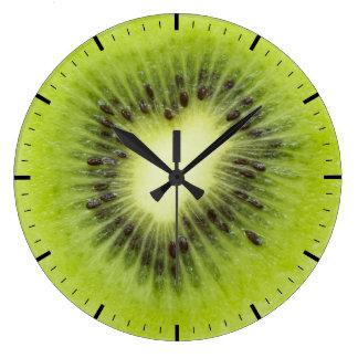 Fresh kiwi fruit. Round slice closeup isolated Large Clock