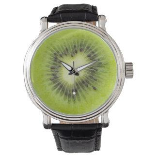 Fresh kiwi fruit. Round slice closeup isolated Watch