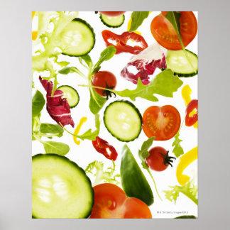 Fresh mixed salad vegetables falling to camera poster