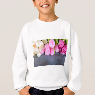 Fresh pink tulips on gray stone background sweatshirt