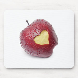 Fresh red apple with a heart shaped symbol mouse pad