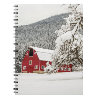 Fresh snow on red barn spiral note books