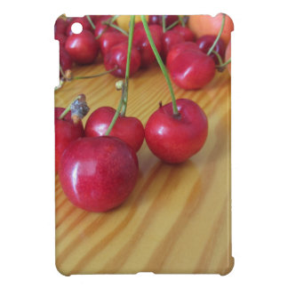 Fresh summer fruits on light wooden table case for the iPad mini