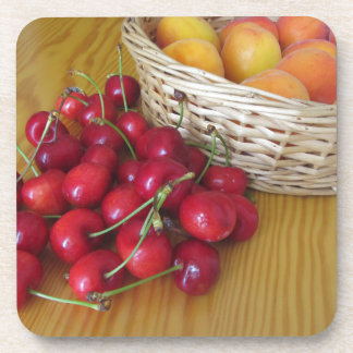 Fresh summer fruits on light wooden table coaster