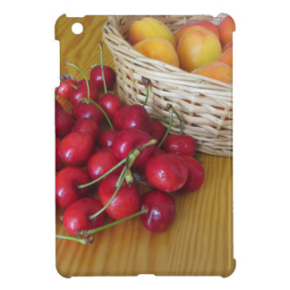 Fresh summer fruits on light wooden table cover for the iPad mini