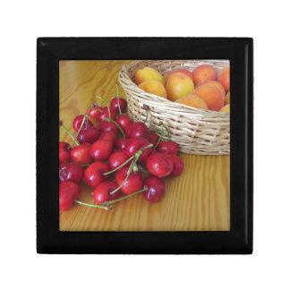 Fresh summer fruits on light wooden table gift box