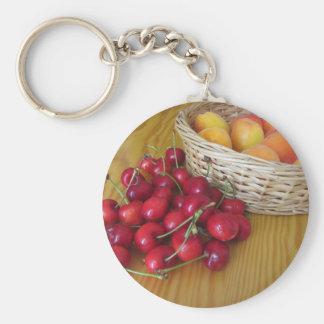 Fresh summer fruits on light wooden table key ring