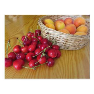 Fresh summer fruits on light wooden table postcard
