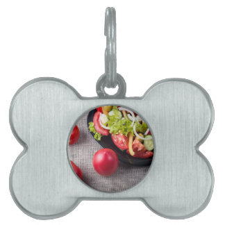 Fresh tomatoes and a part of a plate pet ID tag