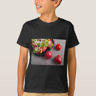 Fresh tomatoes and a part of a plate with salad T-Shirt