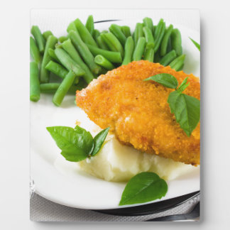 Fried breaded chicken, green beans and mash plaque