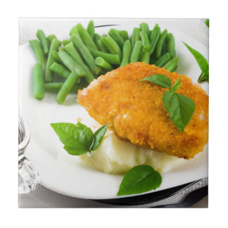 Fried breaded chicken, green beans and mash tile
