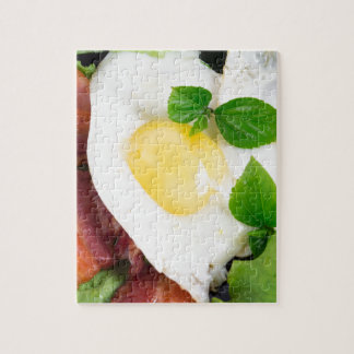Fried eggs and bacon with herbs and lettuce jigsaw puzzle