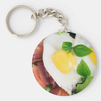 Fried eggs and bacon with herbs and lettuce key ring