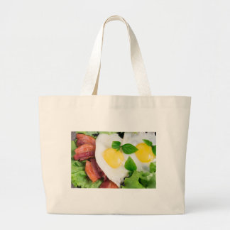 Fried eggs and bacon with herbs and lettuce large tote bag