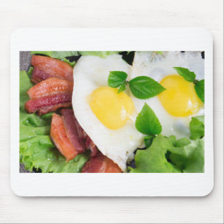 Fried eggs and bacon with herbs and lettuce mouse pad